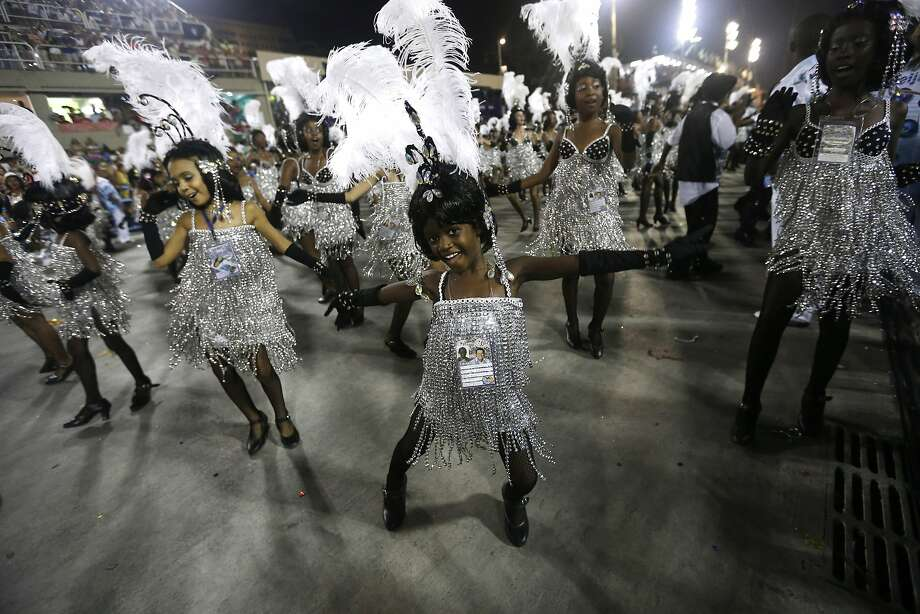 Children from the Beija Flor samba school parade during carnival celebrations at the Sambadrome in Rio de Janeiro, Brazil, Monday, March 3, 2014. (AP Photo/Silvia Izquierdo) Photo: Silvia Izquierdo, Associated Press