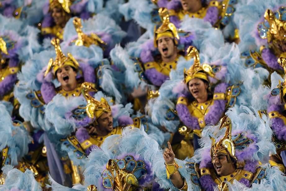 Performers from the Salgueiro samba school parade during carnival celebrations at the Sambadrome in Rio de Janeiro, Brazil, Monday, March 3, 2014. (AP Photo/Felipe Dana) Photo: Felipe Dana, Associated Press