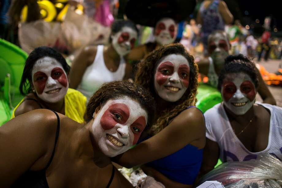 "Members of Grande Rio samba school get ready prior to their entrance as part of the 2014 Brazilian Carnival at Sapucai Sambadrome on March 02, 2014 in Rio de Janeiro, Brazil. Rio's two nights of Carnival parades begin on March 2 in a burst of fireworks and to the cheers of thousands of tourists and locals who have previously enjoyed street celebrations (known as ""blocos de rua"") all around the city. Photo: Buda Mendes, Getty Images"