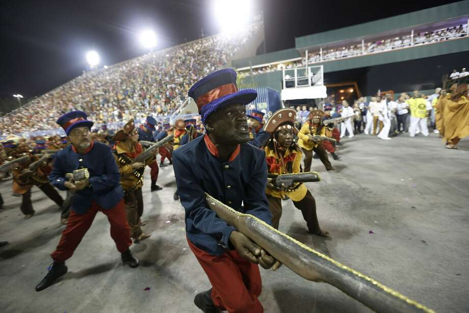 Performers from the Sao Clemente samba school parade during carnival celebrations at the Sambadrome in Rio de Janeiro, Brazil, Monday, March 3, 2014. (AP Photo/Silvia Izquierdo) Photo: Silvia Izquierdo, Associated Press