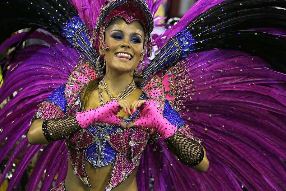 A performer from the Sao Clemente samba school parades through the Sambadrome for carnival in Rio de Janeiro, Brazil, Monday, March 3, 2014. (AP Photo/Nelson Antoine) Photo: Nelson Antoine, Associated Press
