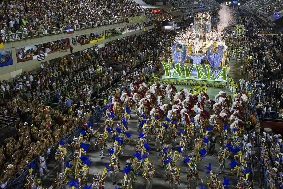 Performers from the Sao Clemente samba school parade during carnival celebrations at the Sambadrome in Rio de Janeiro, Brazil, Monday, March 3, 2014. (AP Photo/Felipe Dana) Photo: Felipe Dana, Associated Press