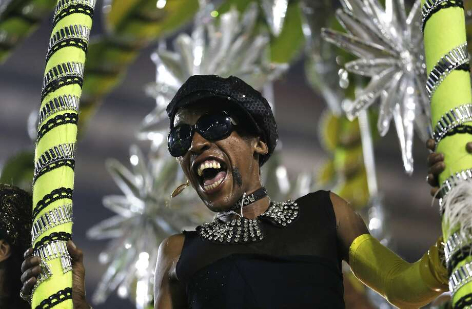 A performer from the Sao Clemente samba school parades during carnival celebrations at the Sambadrome in Rio de Janeiro, Brazil, Monday, March 3, 2014. (AP Photo/Silvia Izquierdo) Photo: Silvia Izquierdo, Associated Press