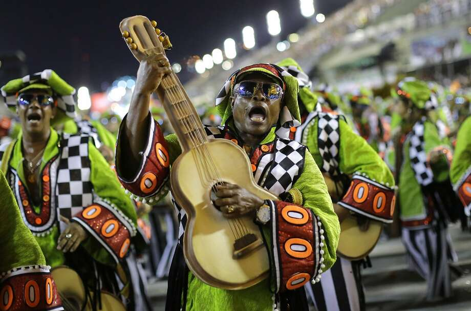 Performers from the Academicos do Grande Rio samba school parade during carnival celebrations at the Sambadrome in Rio de Janeiro, Brazil, Sunday, March 2, 2014. (AP Photo/Nelson Antoine) Photo: Nelson Antoine, Associated Press