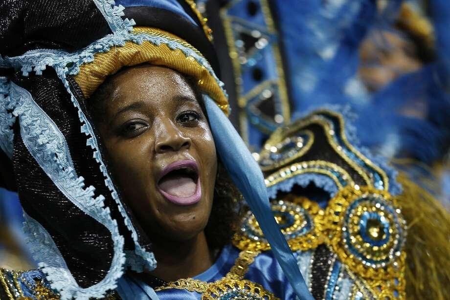 A performer from the Imperio da Tijuca samba school parades during carnival celebrations at the Sambadrome in Rio de Janeiro, Brazil, Sunday, March 2, 2014. (AP Photo/Silvia Izquierdo) Photo: Silvia Izquierdo, Associated Press