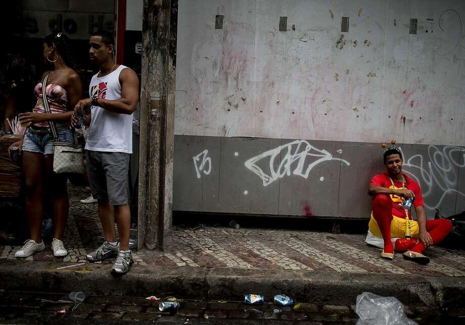 RIO DE JANEIRO, BRAZIL - MARCH 01: People attend the 'Cordao da Bola Preta' traditional street carnival parade at Rio Branco avenue on March 01, 2014 in Rio de Janeiro, Brazil. (Photo by Buda Mendes/Getty Images) Photo: Buda Mendes, Getty Images
