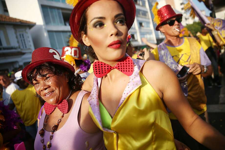 RIO DE JANEIRO, BRAZIL - MARCH 02:  Revelers parade during the 'Simpatia e Quase Amor' street carnival bloco along Ipanema Beach on March 2, 2014 in Rio de Janeiro, Brazil. Carnival is the grandest holiday in Brazil, annually drawing millions in raucous celebrations.  (Photo by Mario Tama/Getty Images) Photo: Mario Tama, Getty Images