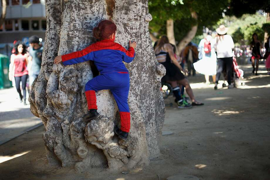 Fighting crime one oak at a time: A 4-year-old Spider-Woman named Lucia climbs a tree at the Santa Cruz de Tenerife Carnival on the Canary island of Tenerife, Spain. Photo: Pablo Blazquez Dominguez, Getty Images