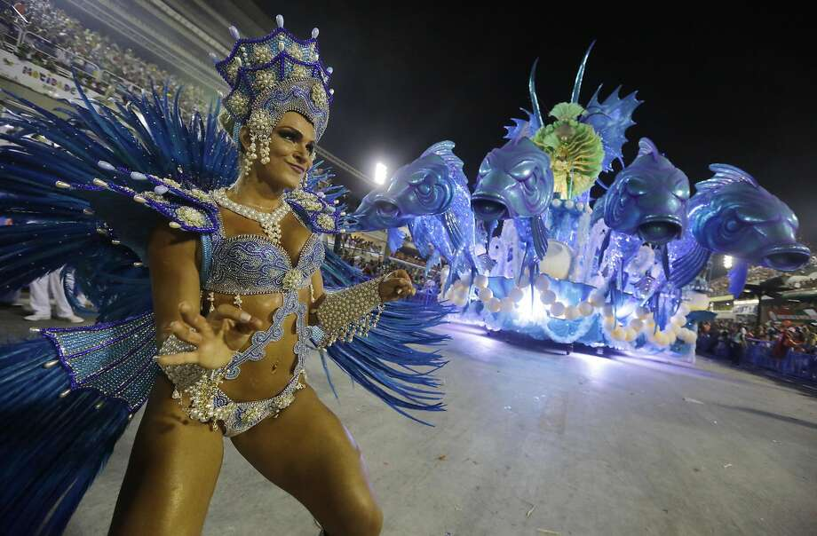Performers from the Salgueiro samba school parade during carnival celebrations at the Sambadrome in Rio de Janeiro, Brazil, Monday, March 3, 2014. (AP Photo/Nelson Antoine) Photo: Nelson Antoine, Associated Press