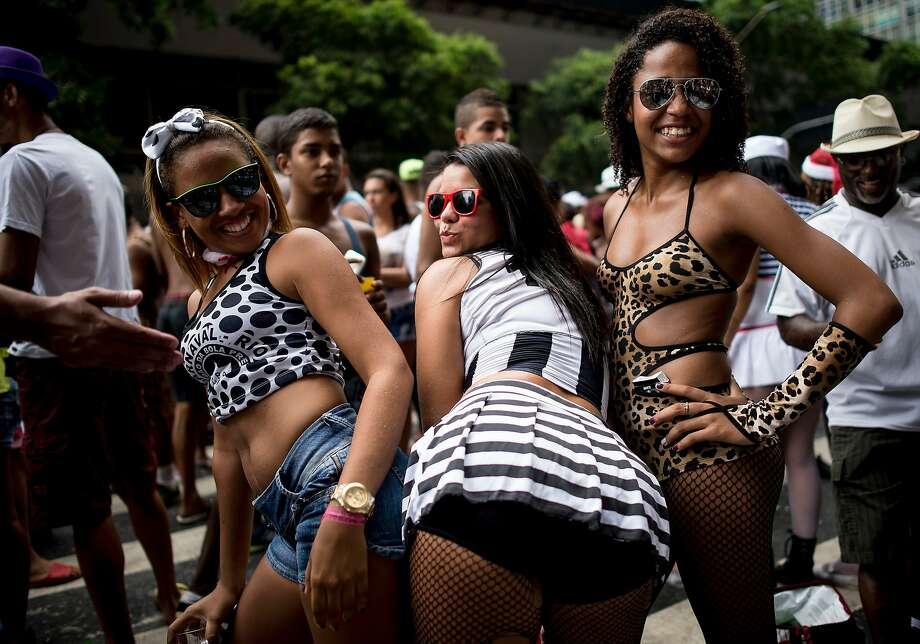 People attend the 'Cordao da Bola Preta' traditional street carnival parade at Rio Branco avenue on March 01, 2014 in Rio de Janeiro, Brazil. Photo: Buda Mendes, Getty Images
