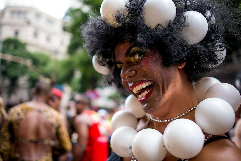 People attend the 'Cordao da Bola Preta' traditional street carnival parade at Rio Branco avenue on March 01, 2014 in Rio de Janeiro, Brazil. Photo: Buda Mendes, Getty Images