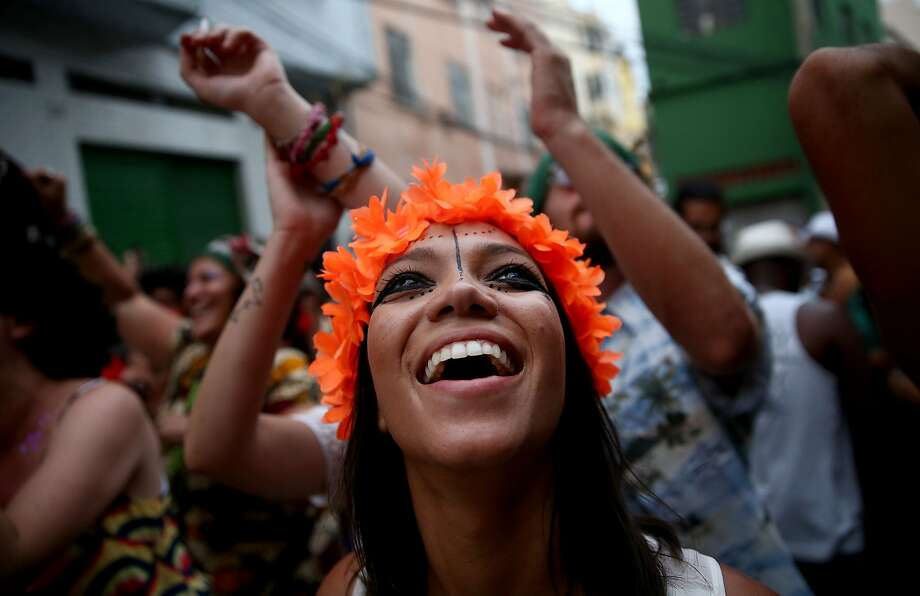 Revelers march during the 'Cordao do Prata Preta' street carnival bloco on March 1, 2014 in Rio de Janeiro, Brazil. Carnival is the grandest holiday in Brazil, annually drawing millions in raucous celebrations. Photo: Mario Tama, Getty Images