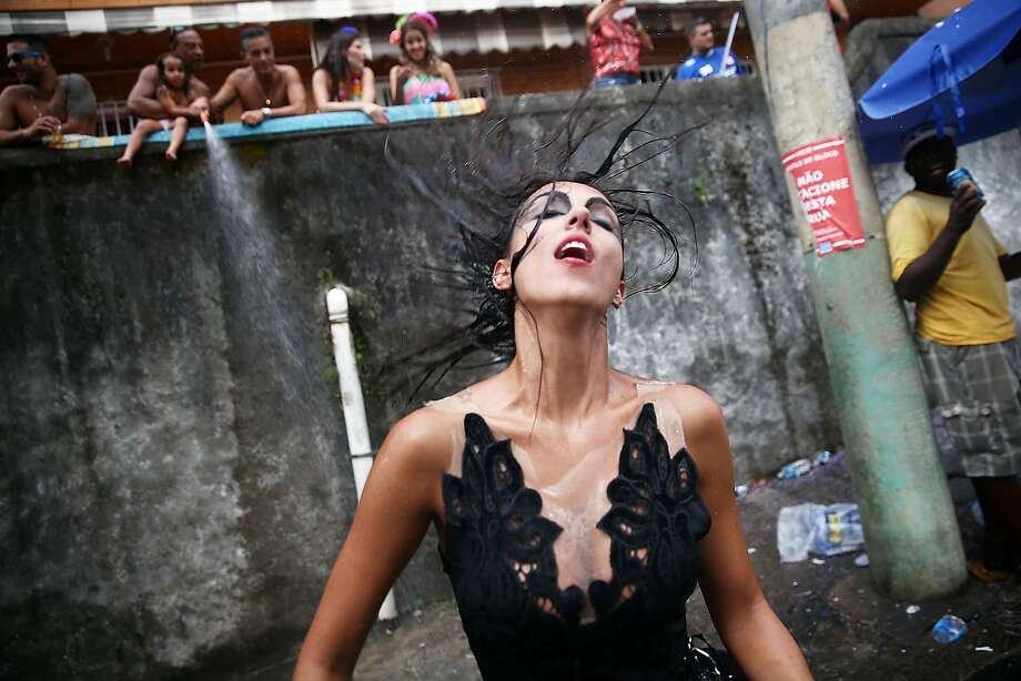 A reveler dances during the 'Ceu na Terra' street carnival bloco on March 1, 2014 in Rio de Janeiro, Brazil. Carnival is the grandest holiday in Brazil, annually drawing millions in raucous celebrations. Photo: Mario Tama, Getty Images