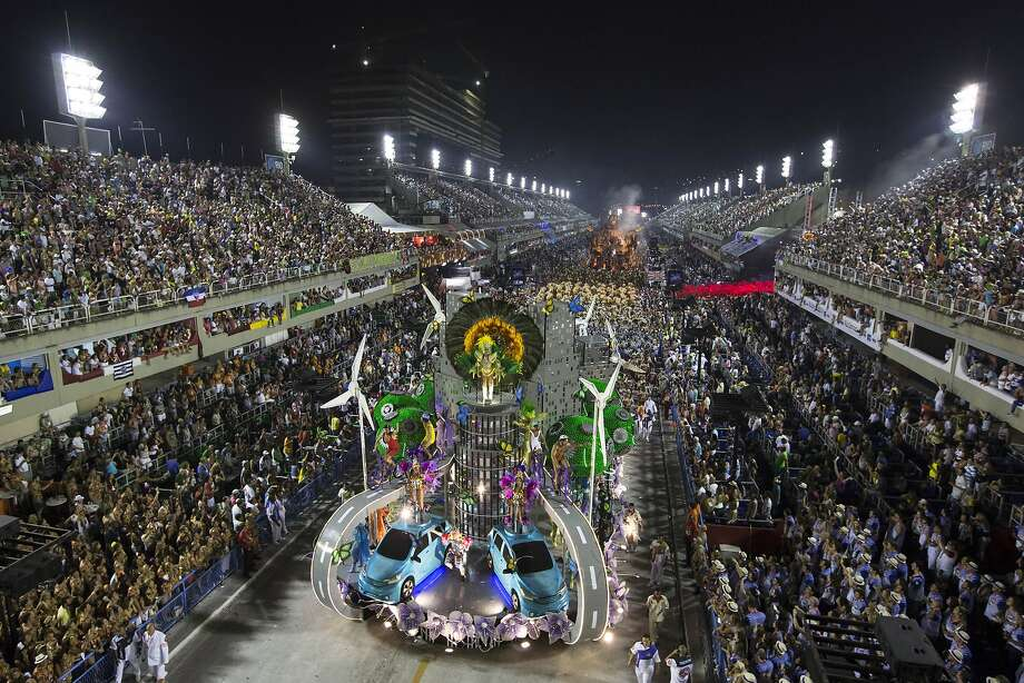 Performers from the Salgueiro samba school parade on a float during carnival celebrations at the Sambadrome in Rio de Janeiro, Brazil, Monday, March 3, 2014. (AP Photo/Felipe Dana) Photo: Felipe Dana, Associated Press