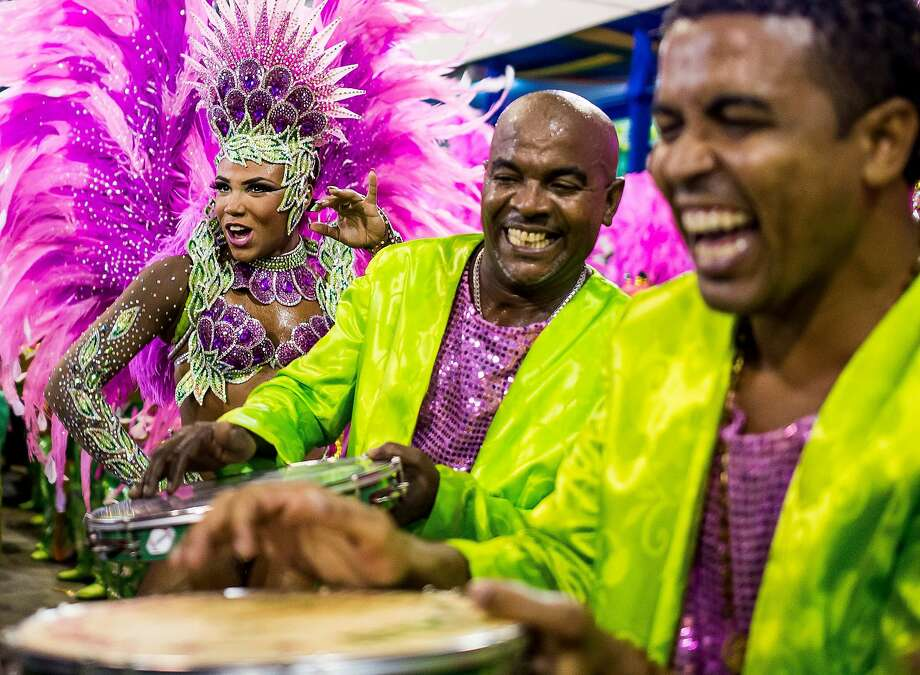 "Queen of Percussion Evelyn Bastos of Mangueira celebrates during their parade at 2014 Brazilian Carnival at Sapucai Sambadrome on March 02, 2014 in Rio de Janeiro, Brazil. Rio's two nights of Carnival parades begin on March 2 in a burst of fireworks and to the cheers of thousands of tourists and locals who have previously enjoyed street celebrations (known as ""blocos de rua"") all around the city.  Photo: Buda Mendes, Getty Images"