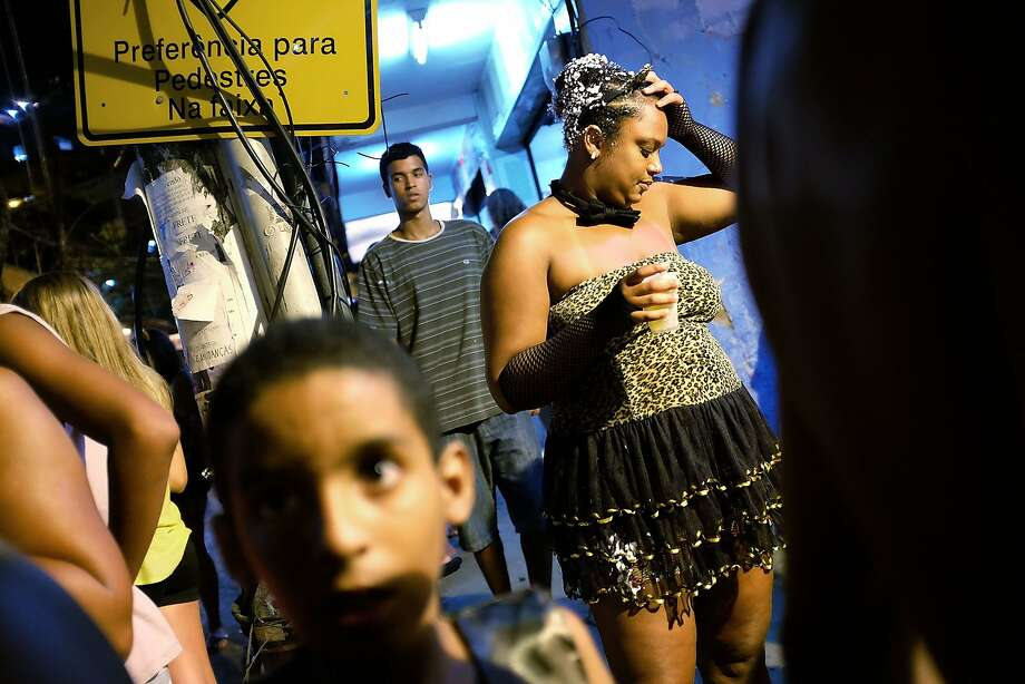 Revelers gather during a street carnival bloco in the Rocinha community, or favela, on March 2, 2014 in Rio de Janeiro, Brazil. Carnival is the grandest holiday in Brazil, annually drawing millions in raucous celebrations. Photo: Mario Tama, Getty Images