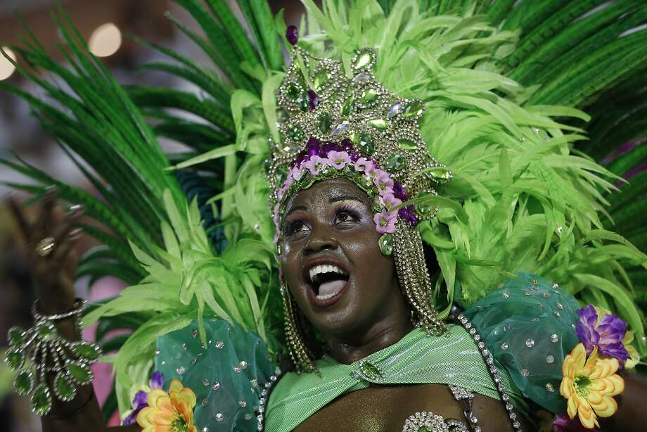 Performer from the Mangueira samba school parades during carnival celebrations at the Sambadrome in Rio de Janeiro, Brazil, Monday, March 3, 2014. (AP Photo/Silvia Izquierdo) Photo: Silvia Izquierdo, Associated Press