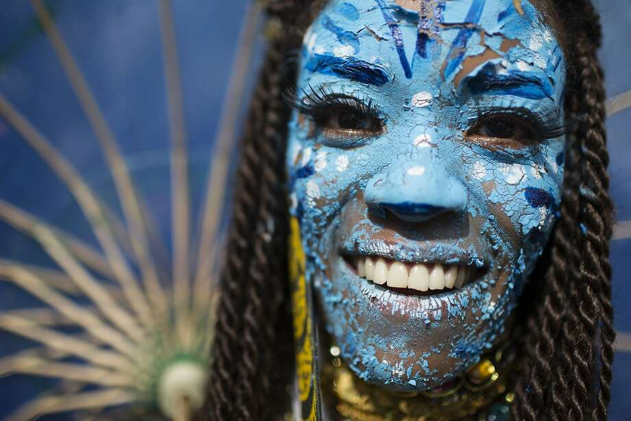 "A reveler dressed as a character from the movie Avatar poses for a photo at the 'Ceu na Terra' block party during Carnival celebration in Rio de Janeiro, Brazil, Saturday, March 1, 2014. Rio de Janeiro's over-the-top Carnival is the highlight of the year for many local residents. Hundreds of thousands of merrymakers will take to Rio's streets in the nearly 500 open-air ""bloco"" parties. Photo: Felipe Dana, Associated Press"