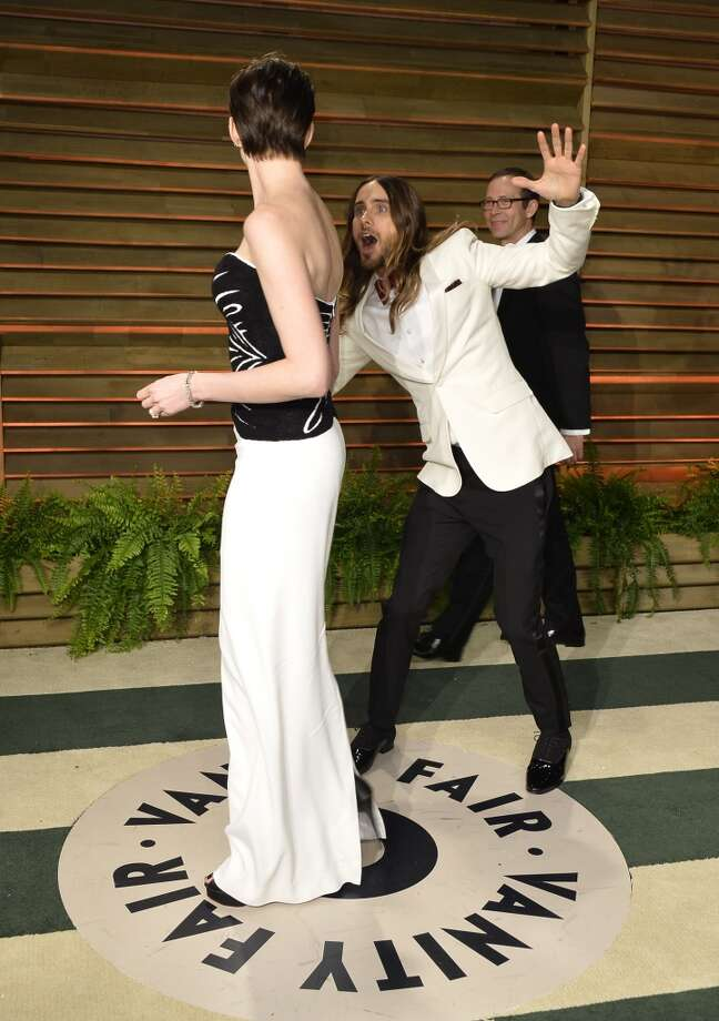 Actors Anne Hathaway (L) and Jared Leto attend the 2014 Vanity Fair Oscar Party hosted by Graydon Carter on March 2, 2014 in West Hollywood, California. Photo: Pascal Le Segretain, Getty Images