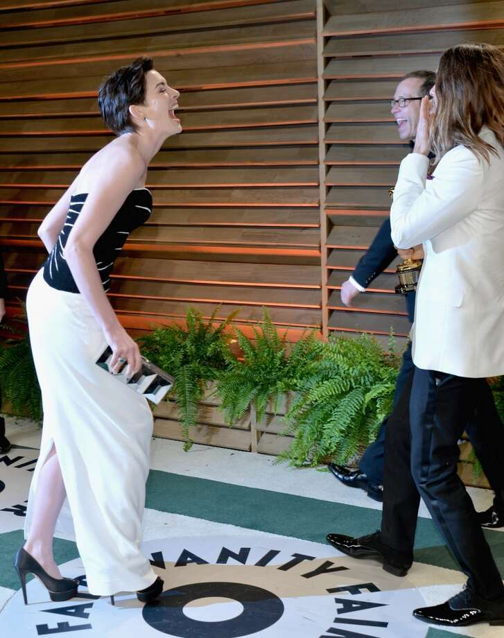 Actors Anne Hathaway (L) and Jared Leto attend the 2014 Vanity Fair Oscar Party hosted by Graydon Carter on March 2, 2014 in West Hollywood, California. Photo: Alberto E. Rodriguez, WireImage