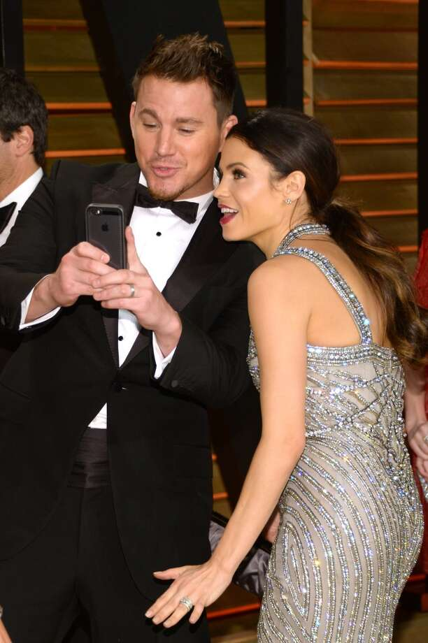 Channing Tatum, left, and Jenna Dewan-Tatum take a photo together at the 2014 Vanity Fair Oscar Party, on Sunday, March 2, 2014, in West Hollywood, Calif. Photo: Evan Agostini, Associated Press
