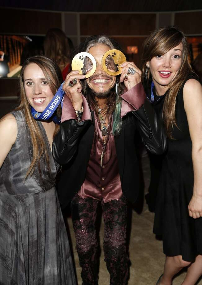 (L-R) Olympic skier Maddie Bowman, musician Steven Tyler, and olympic skier Mikaela Shiffrin attend the 2014 Vanity Fair Oscar Party Hosted By Graydon Carter on March 2, 2014 in West Hollywood, California. Photo: Jeff Vespa/VF14, WireImage