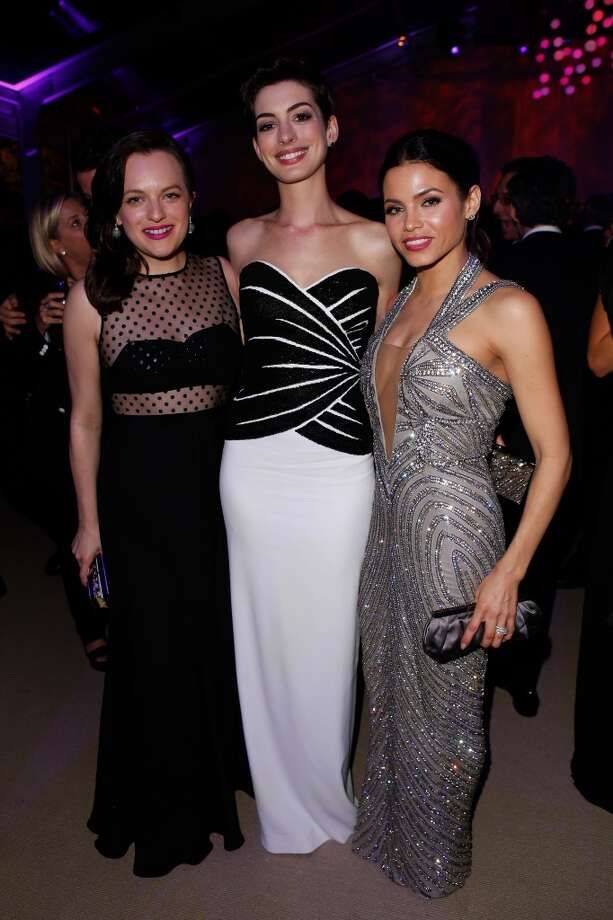 (L-R) Actresses Elisabeth Moss, Anne Hathaway, and Jenna Dewan-Tatum attend the 2014 Vanity Fair Oscar Party Hosted By Graydon Carter on March 2, 2014 in West Hollywood, California. Photo: Jeff Vespa/VF14, WireImage