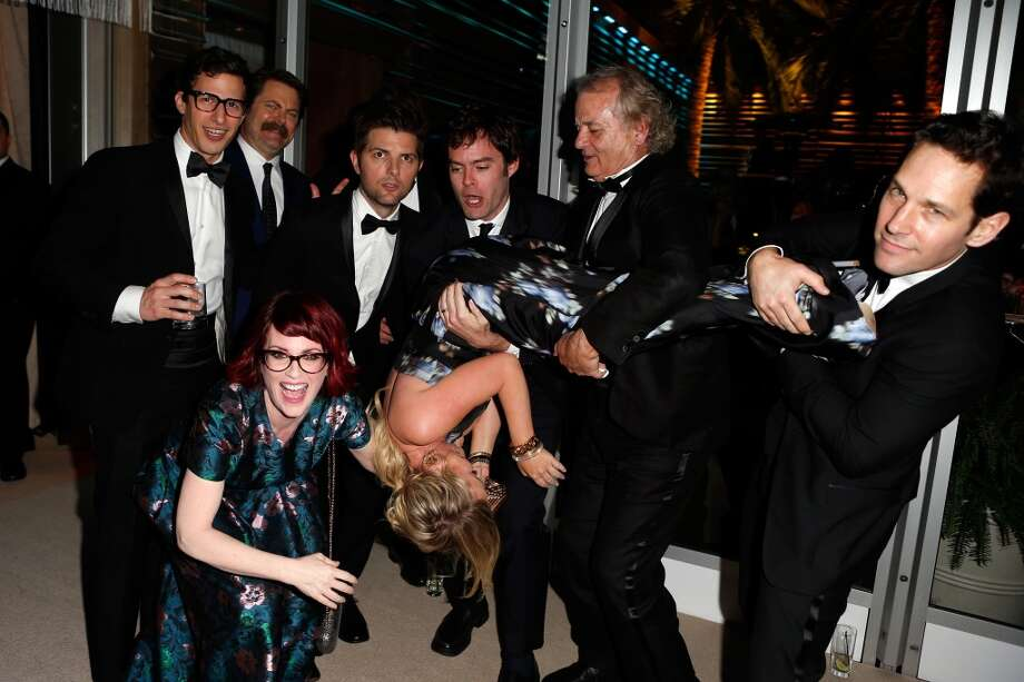 (L-R) Actors Andy Samberg, Nick Offerman, Megan Mullally (crouching), Adam Scott, Amy Poehler (being held upside-down), Bill Hader, Bill Murray, and Paul Rudd attend the 2014 Vanity Fair Oscar Party Hosted By Graydon Carter on March 2, 2014 in West Hollywood, California. Photo: Jeff Vespa/VF14, WireImage