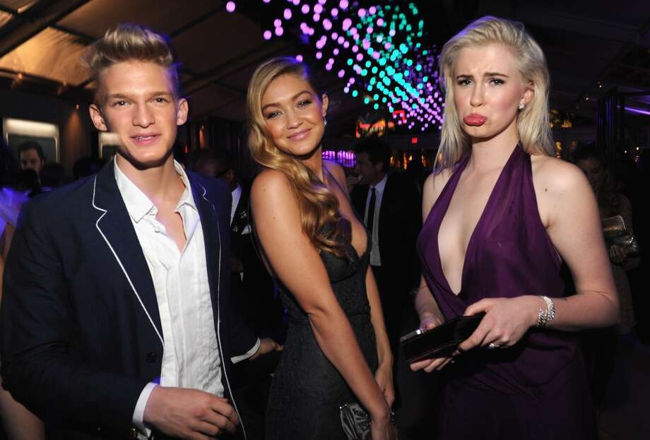 Gigi Hadid, Cody Simpson and Ireland Baldwin attend the 2014 Vanity Fair Oscar Party Hosted By Graydon Carter on March 2, 2014 in West Hollywood, California. Photo: Kevin Mazur/VF14, WireImage