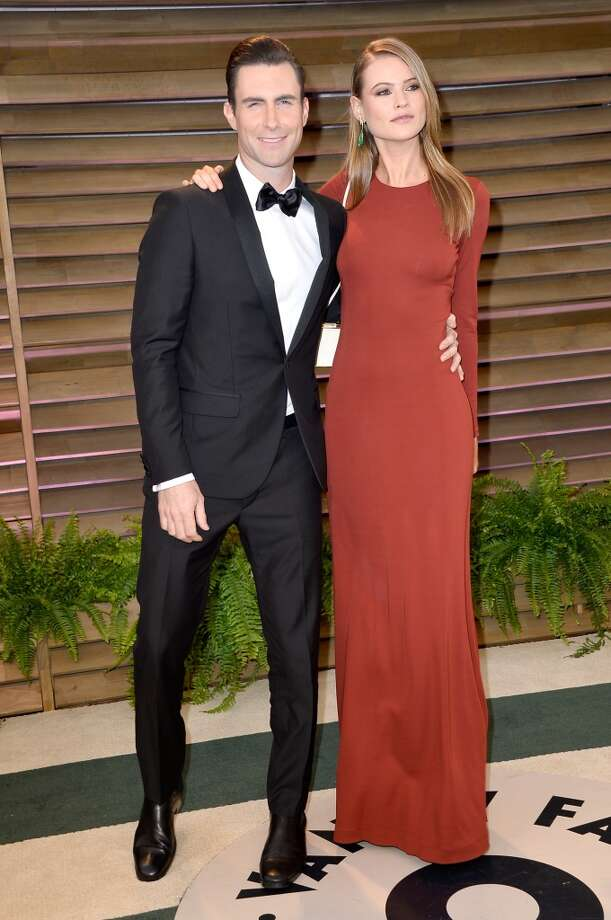 Musician Adam Levine (L) and model Behati Prinsloo attends the 2014 Vanity Fair Oscar Party hosted by Graydon Carter on March 2, 2014 in West Hollywood, California. Photo: Pascal Le Segretain, Getty Images