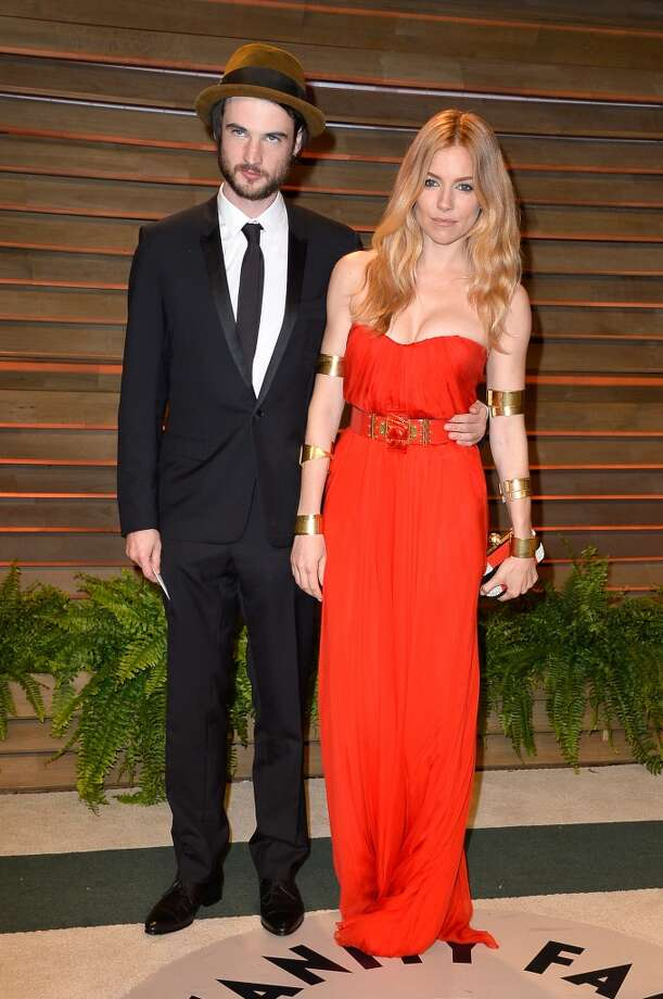 Actors Tom Sturridge (L) and Sienna Miller attend the 2014 Vanity Fair Oscar Party hosted by Graydon Carter on March 2, 2014 in West Hollywood, California. Photo: Pascal Le Segretain, Getty Images