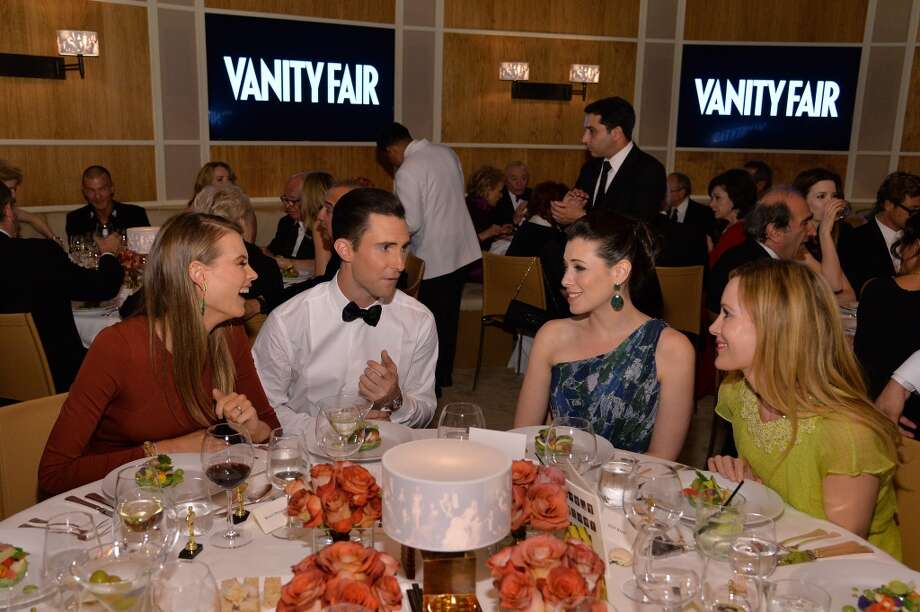 (L-R) Model Behati Prinsloo, musician Adam Levine, actresses Lauren Miller, and Leslie Mann attend the 2014 Vanity Fair Oscar Party Viewing Dinner Hosted By Graydon Carter on March 2, 2014 in West Hollywood, California. Photo: Larry Busacca, Getty Images