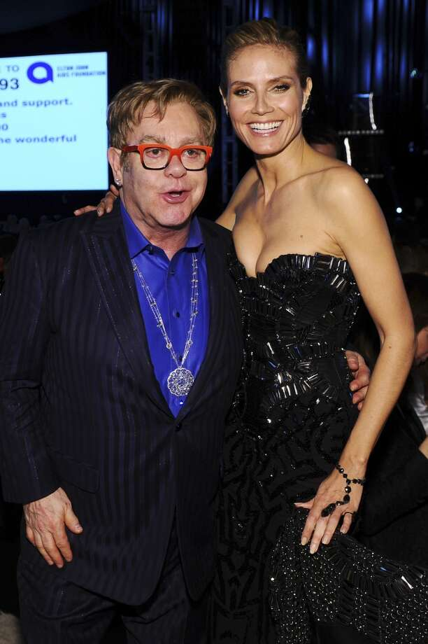 Sir Elton John and model/TV personality Heidi Klum attend the 22nd Annual Elton John AIDS Foundation Academy Awards Viewing Party at The City of West Hollywood Park on March 2, 2014 in West Hollywood, California. Photo: Dimitrios Kambouris, Getty Images For EJAF
