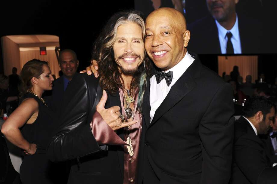 Singer Steven Tyler (L) and Russell Simmons attend the 22nd Annual Elton John AIDS Foundation Academy Awards Viewing Party at The City of West Hollywood Park on March 2, 2014 in West Hollywood, California. Photo: Dimitrios Kambouris, Getty Images For EJAF
