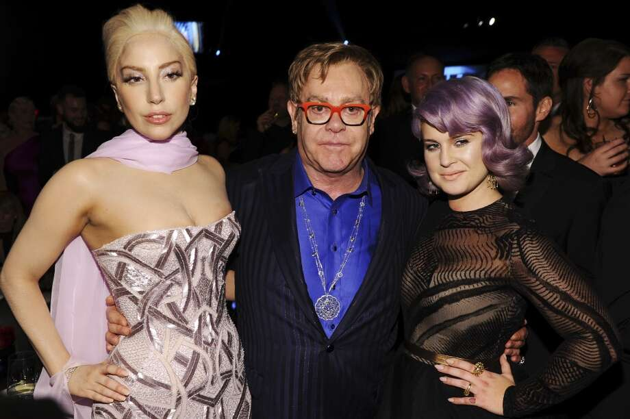 (L-R) Recording artist Lady Gaga, Sir Elton John, and TV personality Kelly Osbourne attend the 22nd Annual Elton John AIDS Foundation Academy Awards Viewing Party at The City of West Hollywood Park on March 2, 2014 in West Hollywood, California. Photo: Dimitrios Kambouris, Getty Images For EJAF