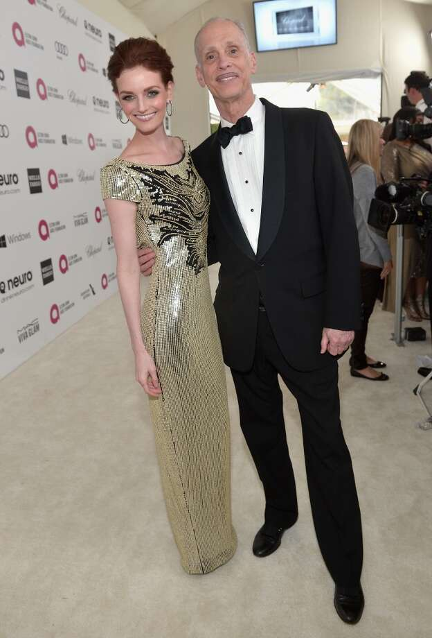 Director John Waters (R) and actress Lydia Hearst attend Neuro at the 22nd Annual Elton John AIDS Foundation Academy Awards Viewing Party at The City of West Hollywood Park on March 2, 2014 in West Hollywood, California. Photo: Charley Gallay, Getty Images For Neuro