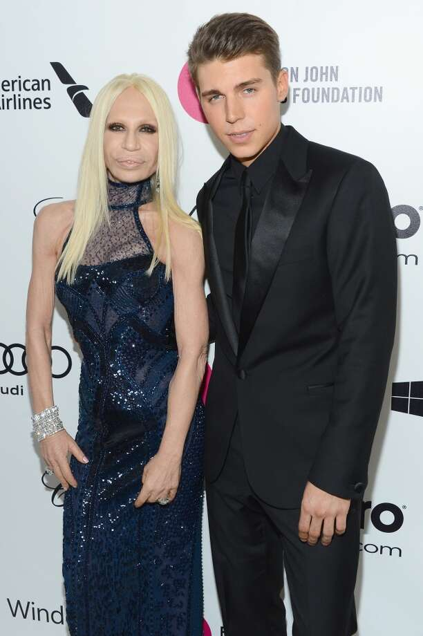 Donatella Versace (L) and Actor Nolan Gerard Funk attends the 22nd Annual Elton John AIDS Foundation's Oscar Viewing Party on March 2, 2014 in Los Angeles, California. Photo: Mark Davis, Getty Images For EJAF