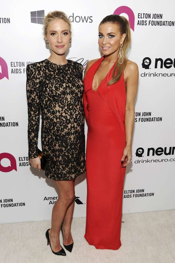 TV personality Kristin Cavallari (L) and model/actress Carmen Electra attend the 22nd Annual Elton John AIDS Foundation Academy Awards Viewing Party at The City of West Hollywood Park on March 2, 2014 in West Hollywood, California. Photo: Dimitrios Kambouris, Getty Images For EJAF