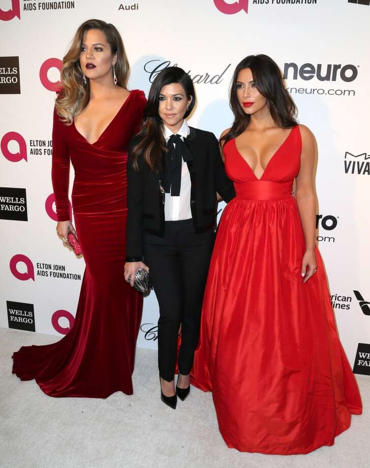 TV personalities Khloe Kardashian, Kourtney Kardashian and Kim Kardashian attend the 22nd Annual Elton John AIDS Foundation's Oscar Viewing Party on March 2, 2014 in Los Angeles, California. Photo: Frederick M. Brown, Getty Images