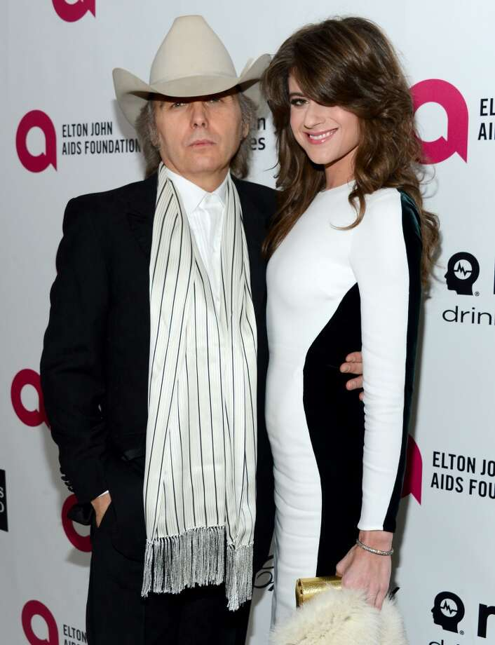 Recording artist/actor Dwight Yoakam (L) and Emily Joy attend the 22nd Annual Elton John AIDS Foundation's Oscar Viewing Party on March 2, 2014 in Los Angeles, California. Photo: Mark Davis, Getty Images For EJAF