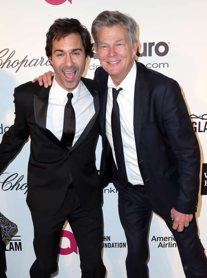 Actor Eric McCormack (L) and composer David Foster attend the 22nd Annual Elton John AIDS Foundation's Oscar Viewing Party on March 2, 2014 in Los Angeles, California. Photo: Frederick M. Brown, Getty Images