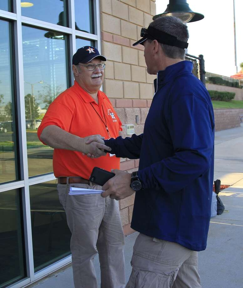 "Craig Biggio talks with head of security ""O.C."" Orvel Cox. Photo: Karen Warren, Houston Chronicle"