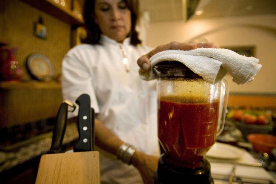Sylvia Casares demonstrates how to make an enchilada sauce. (Photo: Eric Kayne/Chronicle) Photo: Eric Kayne, Houston Chronicle