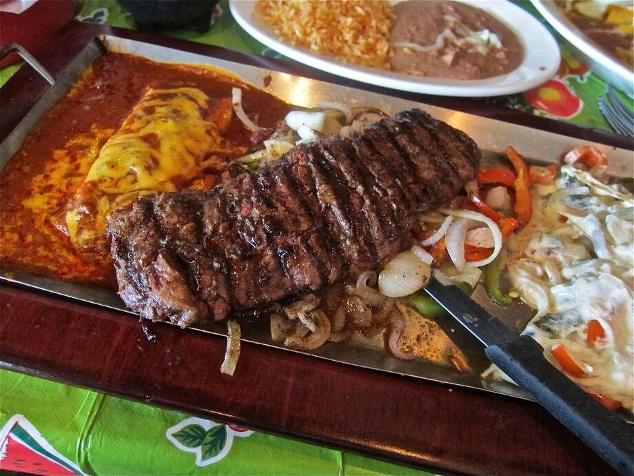 Tampiquena plate with rajas and a cheese enchilada at Sylvia's Enchilada Kitchen. (Photo: Alison Cook) Photo: Alison Cook, Houston Chronicle / Houston Chronicle