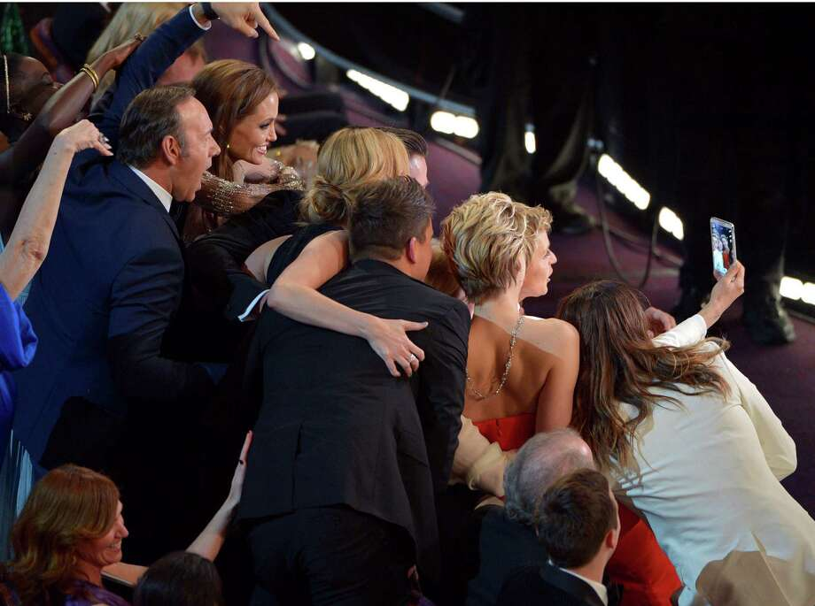 Bonus: here's a look at that Twitter-crashing selfie from the 86th annual Academy Awards from behind.   Photo: John Shearer, John Shearer/Invision/AP / Invision