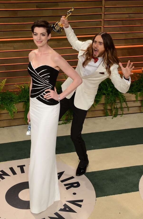 Actress Anne Hathaway gets photobombed by Jared Leto arrive at the 2014 Vanity Fair Oscar Party Hosted By Graydon Carter on March 2, 2014 in West Hollywood, California. Photo: WireImage