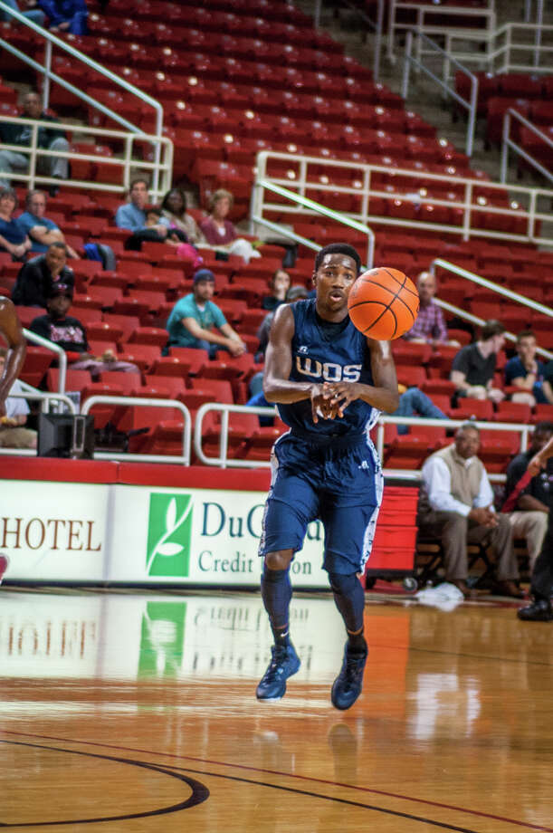 Laquarious Paige of the West Orange-Stark Mustangs, works offense during a matchup against the Cleveland Indians Tuesday night at the Montagne Center. Photo provided by Michael Reed Photo: Michael Reed / Michael Reed