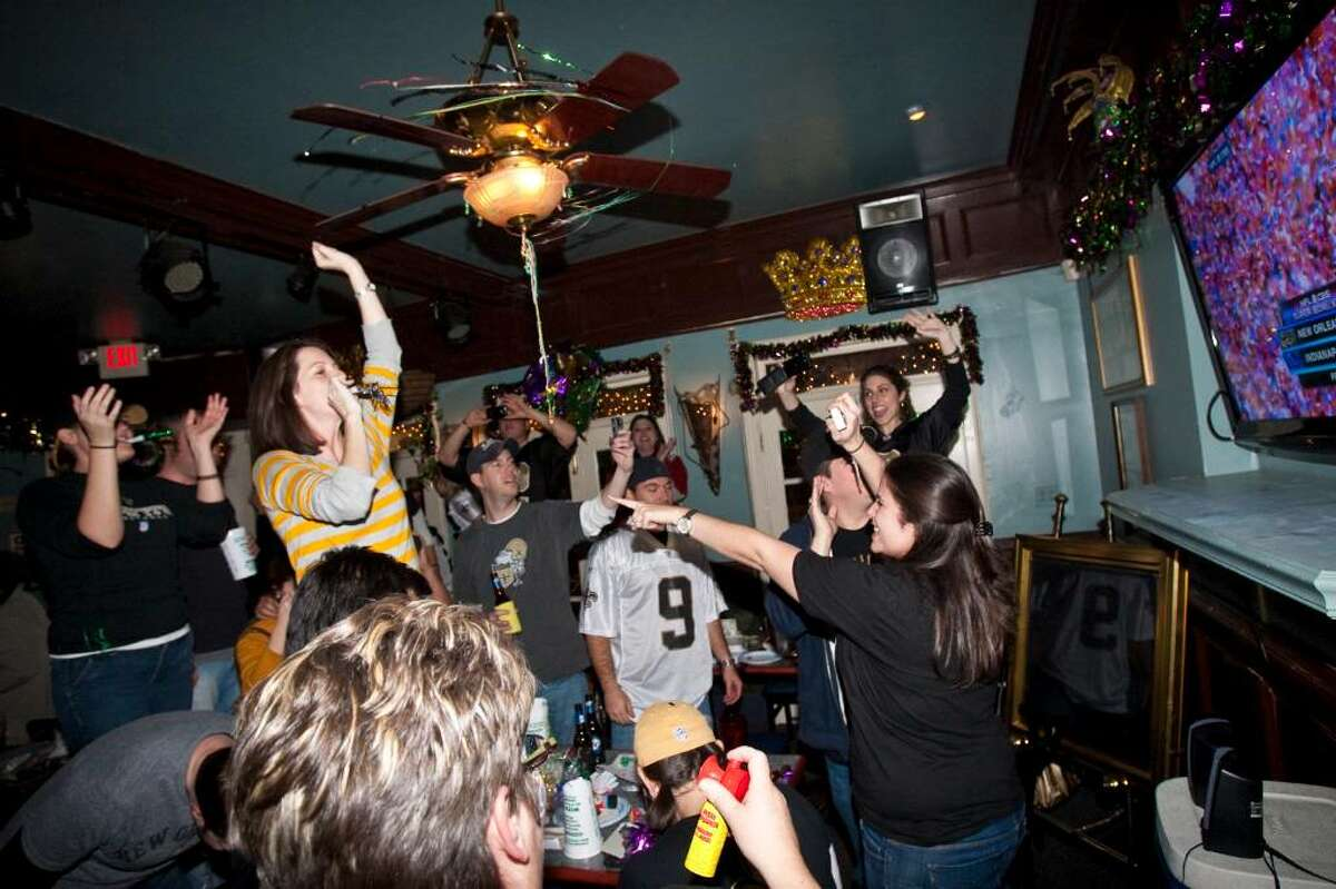 NEW ORLEANS - FEBRUARY 07: Exuberant New Orleans Saints fans celebrate the final winning score of Super Bowl XLIV at the Mid-City neighborhood bar Wit's Inn on February 7, 2010 in New Orleans, Louisiana. (Photo by Skip Bolen/Getty Images)