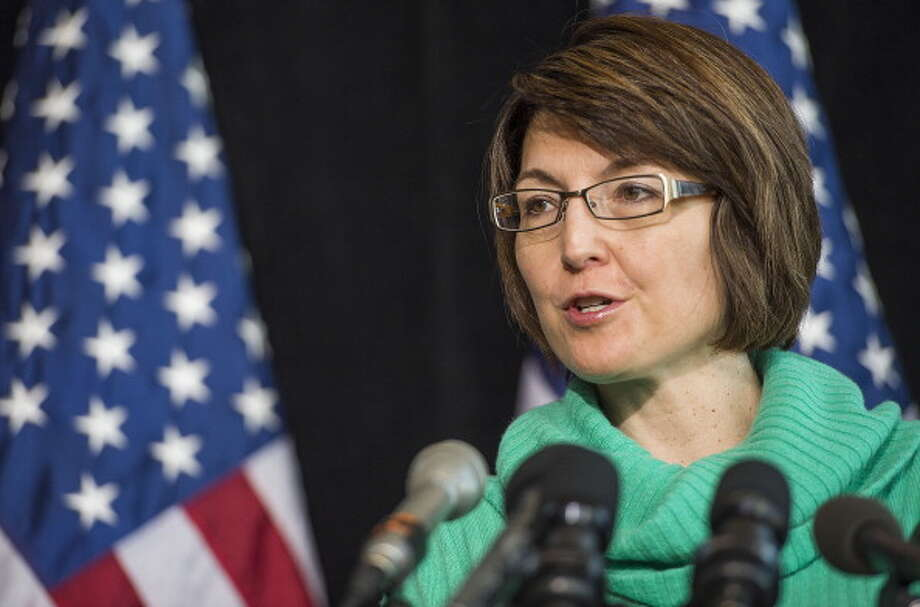 """Known for keeping tight control of her appearances back home in Eastern Washington, Rep. Cathy McMorris Rodgers, R-Wash., was confronted with chants of """"Save Our Health Care"""" when she appeared at a Martin Luther King Day rally in Spokane.  Photo: JIM WATSON, AFP/Getty Images / 2014 AFP"""