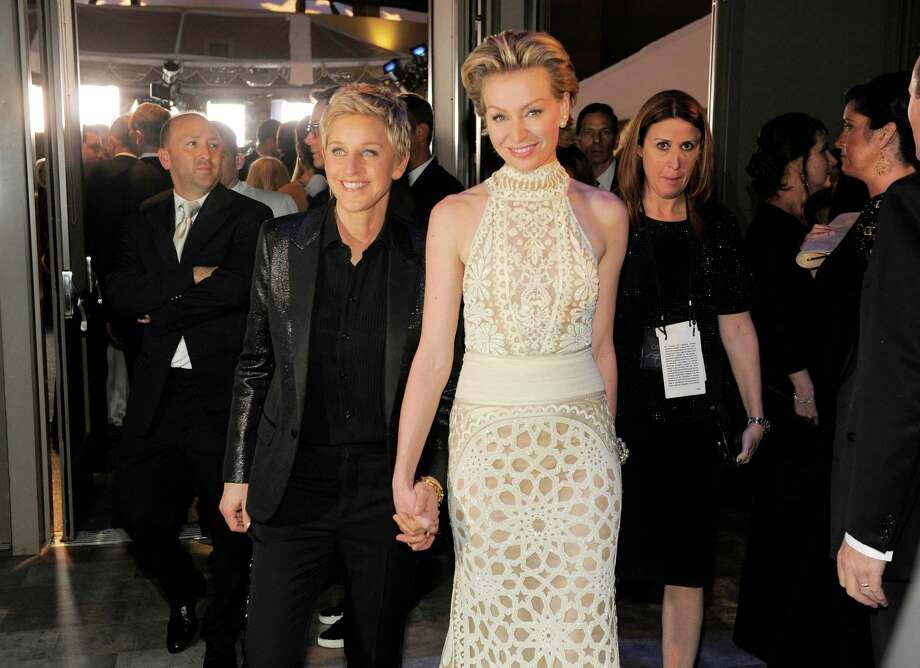 Ellen DeGeneres, left, and Portia de Rossi attend the Governors Ball after the Oscars on Sunday, March 2, 2014, at the Dolby Theatre in Los Angeles.  (Photo by Chris Pizzello/Invision/AP) ORG XMIT: CALW103 Photo: Chris Pizzello / Invision